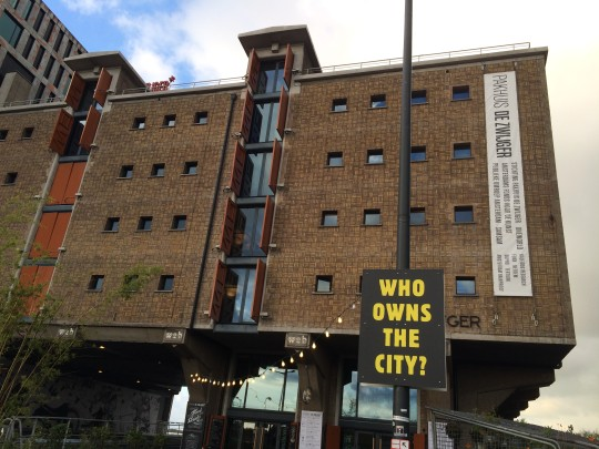 Placard 'WHO OWNS THE CITY?' at Pakhuis de Zwijger, Amsterdam